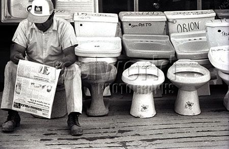 A worker takes a break on a toilet at a hardware store in Chihuahua, Mexico.