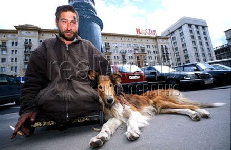 A homeless beggar and his dog wait for hand outs in the center of Moscow, Russia.