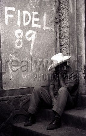 A man takes a nap in a doorway in Managua, Nicaragua, Central America. Gary Moore photo.