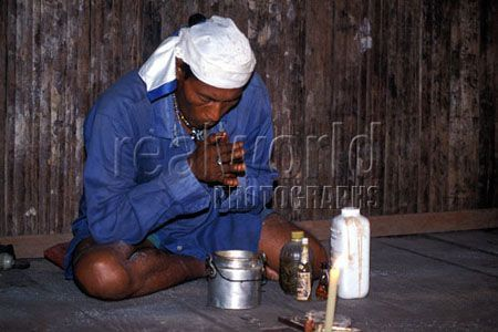 A Peruvian Shaman prays over ayuasca. The Shamans, or Pajés (as they are known in Indian language), are not only the medicine men of the tribes and villages, but are also sorcerers and spiritual guides.