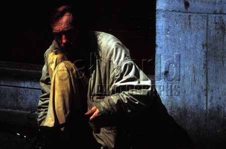 A homeless man hides in the shadows in an alley in Amsterdam, Netherlands in 2004. Holland, Netherlands.
